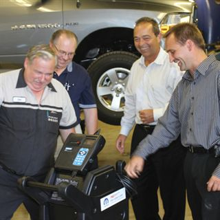 (Left to right): Technician Joe Bellmore — the first technican hired by 'Papa' Dagenais — Service Manager John Malnar, Parts and Service Director Dan Berry and Matt Dagenais share some laughs.