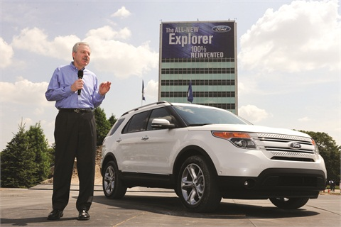 Derrick Kuzak, Ford's group vice president of global product development, reveals the 2011 Ford Explorer during a special ceremony on July 26, 2010, in Dearborn, Mich. As part of the launch, the Detroit automaker employed a Facebook campaign that attracted more than 138,000 fans to the Explorer's fan page.