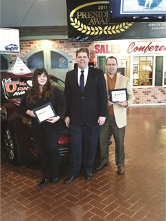 When Bowling Green Lincoln Auto Sales switched F&I providers in October 2013, General Agent Chris Meacham (right) pitched the iTapMenu to the store's GM John Heffernan and Finance Manager Lisa Kline.
