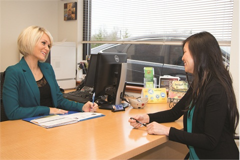 <p>Business managers Camille Kim (left) and Sam Baylasy (right) sell F&I products to about half of the out-of-area customers who buy cars online from Northwest Honda, thanks to a recent process change and a push to put F&I online.</p>