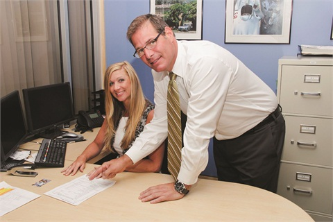 Finance Manager Trisha Winski  pictured with Chris Palmer, the dealership's pre-owned manager.