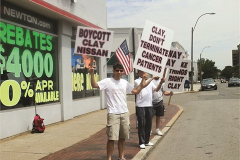 Adam and Jonathan Colter organized two separate protests this summer at Clay Nissan of Norwood, Massachusetts. The brothers claim the dealer fired their sister because she had cancer, charges the dealer has denied.