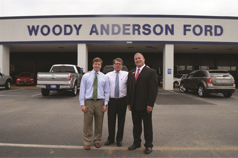 Blake and C.D. Norberg flank Chris Waggett, F&I manager for Woody Anderson Ford in Huntsville, Ala. Their general agency helped the dealership make the switch to a four-tier GAP pricing model in late 2011.