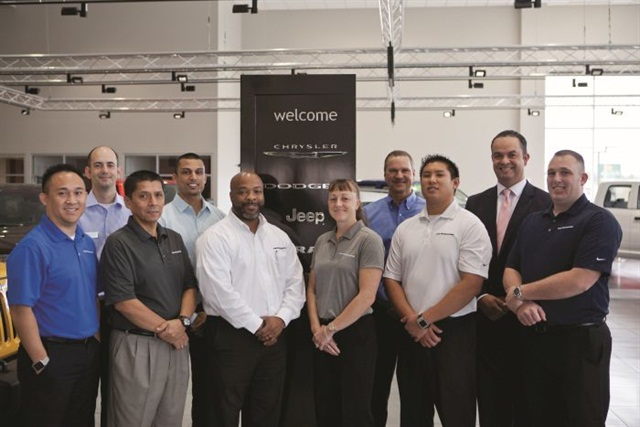 Pictured are members of Davis-Moore's F&I team, including (l-r) Max Inthavongsay, Dominic Feld, Fernando Cruzado, Satya Sudarsan, IC Collins, Dena Moore, Faron Cassity, Eric Kaska, EFG Companies' Gabe Aldrete, and Mat Rudd. Photo courtesy of Squid Ink creativ