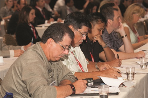 Industry Summit is also the place to learn from the industry's top F&I trainers. Pictured are attendees taking notes during one of the event's many training sessions.