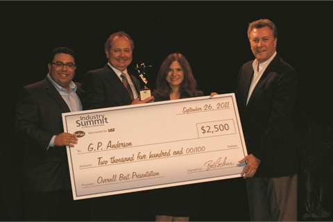 GP Anderson accepts his trophy and prize money from the magazine's executive editor, Gregory Arroyo, Industry Summit event manager Adriana Michaels and Bob Corbin, president of IAS.