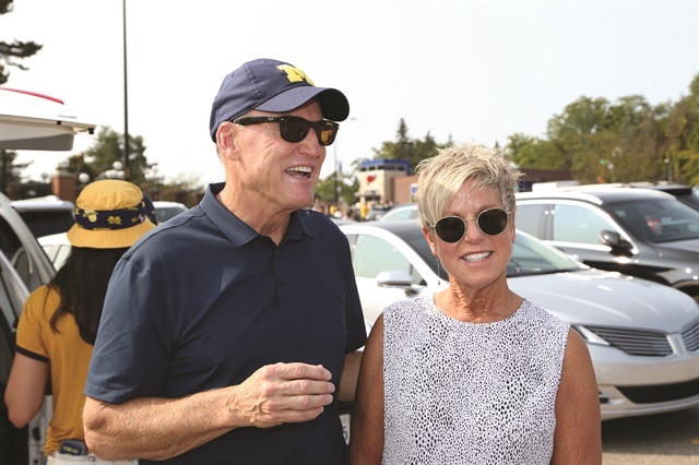 Wes Lutz attends a tailgate party with his wife, Judy, at the University of Michigan, his alma mater, in Ann Arbor in September 2017. Lutz is the second consecutive chairman to hail from the Great Lakes region, having succeeded Chicago-area dealer and 2017 Chairman Mark Scarpelli. Texas dealer Charlie Gilchrist will serve as the 2018 vice chair. (Photo courtesy of the NADA)