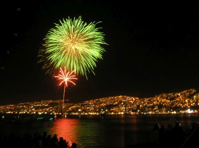 Revelers cheer New Year's fireworks in Valparaiso, Chile. Photo by Andrés Aguiluz Rios