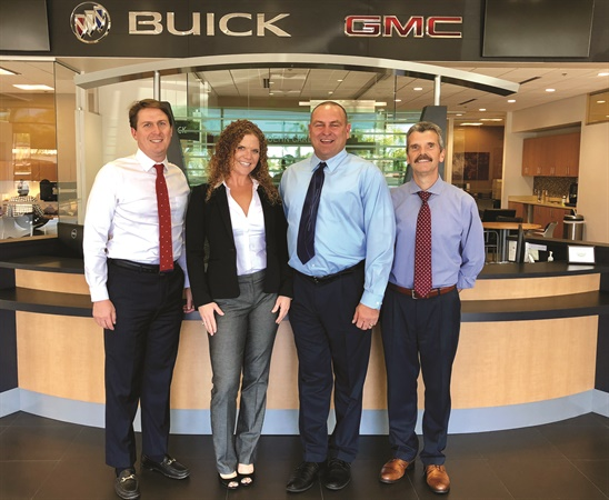 """Flanking F&I managers Megan Phillips and Richard Thorton are group F&I Director Josh Sherman (l) and store General Manager Jerry Brummet. The group has high expectations for its F&I producers, which is why candidates must have worked in another area within the organization and attended """"Hoehn University."""" The eight-week course, which is led by general managers from each of the group's stores, covers a number of topics related to ethics and compliance."""