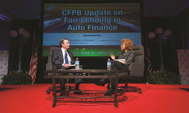 Patrice Ficklin, assistant director for the CFPB's Office of Fair Lending, takes questions from Chris Stinebert of the American Financial Services Association during the trade group's 2014 Vehicle Finance Conference.