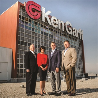 F&I department members Joe Benson, Lisa Bourgeois, Jason Frampton and Jim Hutson stand outside the Ken Garff corporate office in Salt Lake City.