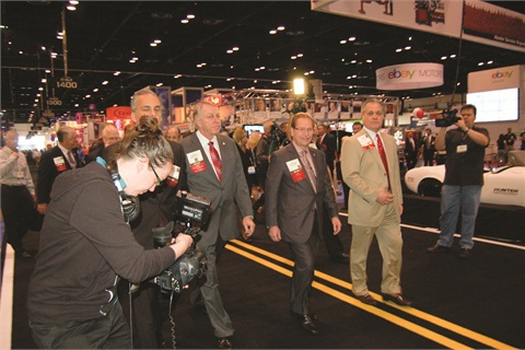 The NADA's leadership takes a tour of the show floor at the association's annual convention.