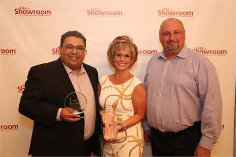 "<p>Sue Bowman poses with F&I and Showroom's Gregory Arroyo, and Eric ""Frenchy"" Mélon, president of sales at IAS. The Sam Pack organization has been a client of the F&I product provider for more than a decade.</p>"