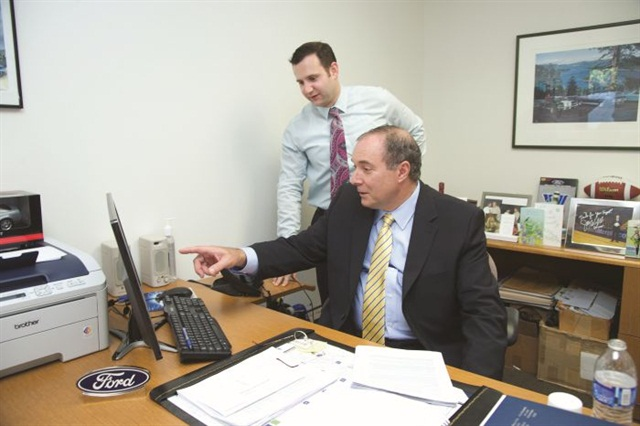 Pacifico Marple's dealer principal, Michael Pacifico (seated), reviews the results of the dealership's proximity marketing campaign with General Sales Manager Jeremy Fisher.