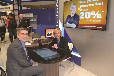 Pictured in front of Reynolds and Reynolds' docuPAD system are Kasi Edwards, vice president of marketing, and Ed Pontis, director of product planning. The latter said the F&I system will play a central role in the new online car-buying experience the company showcased to dealers behind closed doors.