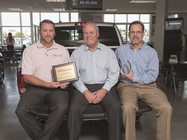 Dealer Mike Dunnahoo poses with F&I Manager Jeremy Johnson and longtime F&I Director Jeff Zinsser, who has been with the group for 22 years. Missing is F&I manager Dan Hall, who has been with Star for 11 years. The team averages $1,872 per copy on new and $1,542 on used.
