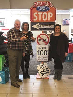 "<p>Pictured are dealer Steve Johnson and his daughters Kelly Johnson, who manages the organization's in-house leasing company, and Kristin Johnson, who can be found most days manning the desk. Johnson refers to them as ""The Sisters of Savings."