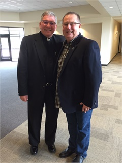 <p>F&I Director Tom Andrews, pictured here with Rev. Russ Mower of St. Jude Catholic Church in Allen, Texas, is always first to arrive and last to leave. The first and third Tuesdays of every month are the exceptions. That's when he drives straight from work to minister to inmates at the youth prison located an hour away from the dealership. He describes it as his 'best hour of the week.'</p>