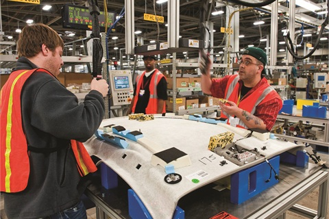 Workers at General Motors' Orion assembly plant in Orion Township, Mich., build Chevrolet Sonics and Buick Veranos in an energy-efficient plant. The author believes GM produces quality products for a strong dealer network.