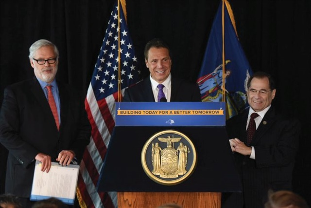 In May, New York Gov. Andrew Cuomo (center) announced the state would begin accepting applications from companies wishing to test self-driving cars on public roads. The author says political support for autonomous technology could ultimately lead to a ban on manually operated vehicles. Photo courtesy Gov. Andrew M. Cuomo