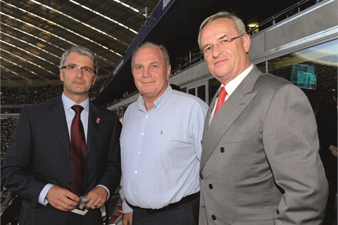 Posing with Rupert Stadler, chairman of AUDI AG, and Uli Hoeness, president of Bayern Munich football team, is Martin Winterkorn, head of Volkswagen AG. Ziegler is a fan of his push to dominate the market by 2018.