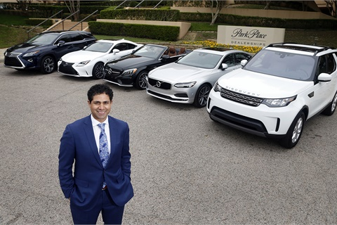 Park Place Dealership's vice president of strategic growth, Hesham Elgahil, stands with a few of the vehicles available to members of the group's new subscription service. Photo via Business Wire