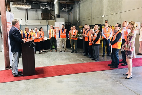 Manheim San Francisco Bay's general manager, Greg Beck, addressed invited guests at the auction's new retail reconditioning center. Photo courtesy Manheim