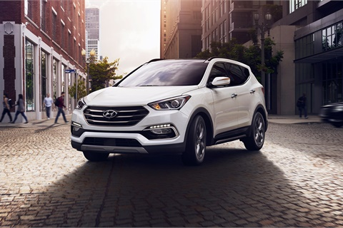 <p><strong>Dealertrack's expanded partnership with Hyundai and Kia's captive finance companies includes a streamlined funding process for vehicles such as the Hyundai Santa Fe Sport. </strong><em>Photo courtesy Hyundai Motor America </em></p>
