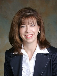 Dawn Martin Harp officially retired as head of Wells Fargo Dealer Services in April.