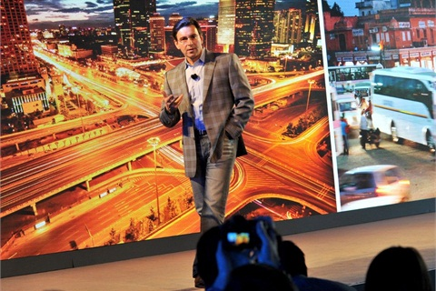 Mark Fields, Ford president and CEO, discusses the company's Ford Smart Mobility plan at the annual Further with Ford trends conference in June.