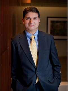 Sanjiv Yajnik, president of Capital One's financial service division