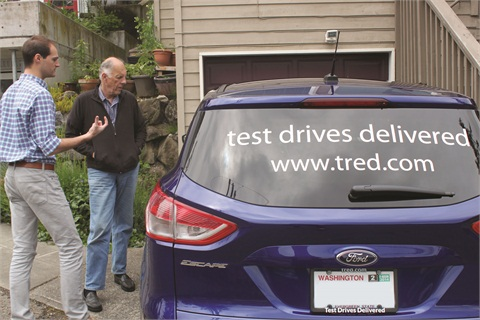 "Tred GM Mike Fingado explains features of the Ford Escape to Burton ""Buzz"" Bruggeman before a Tred test drive near Bruggeman's home."