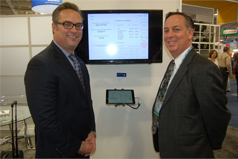 David Putz (left), senior vice president and head of direct markets for Zurich, and Vincent Santivasi (right), vice president of business development for Zurich's F&I division, demoed the company new tablet menu and F&I process at the 2015 NADA Convention & Expo.
